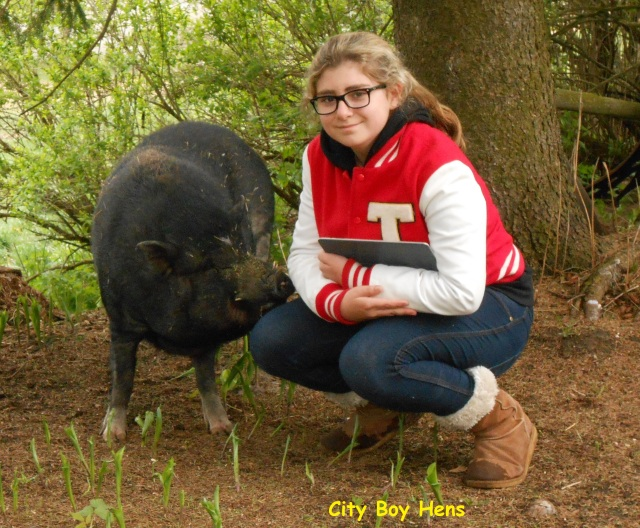 "My daughter with Dan's pig ""Larry""."